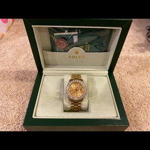 UA Rolex president with diamonds.